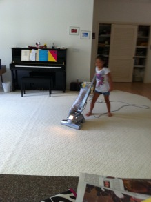 sammie vacuuming